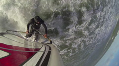 Bird's-eye view of a man windsurfing. Stock Footage