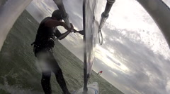 A man windsurfing. Stock Footage
