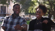 African American couple at a table talking and laughing together Stock Footage