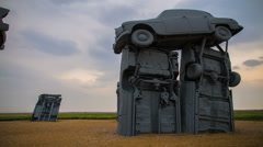 Cars  of America's Stonehenge Under Timelapse Skies Stock Footage