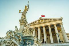 Austrian parliament building with Athena statue Stock Photos