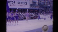 1964: a parade taking place with joy and people are seen enjoying  HARVARD Stock Footage