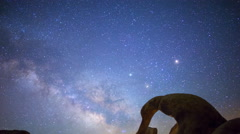 Astro Time Lapse of Milky Way thru Mobius Arch in Alabama Hills -Tilt Down- Stock Footage