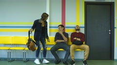 Three students are waiting for when they will be invited for an exam Stock Footage
