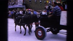 1964: riding a horse car buggy with five passengers and clown at parade  Stock Footage
