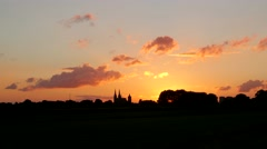 TIMELAPSE Sunset over dutch landscape with church,Cuijk,Netherlands Stock Footage
