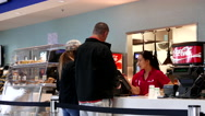 People paying cash for buying foods inside Vancouver aquarium Stock Footage