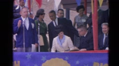 1964: official address the people through the mike on the dais  HARVARD, Stock Footage
