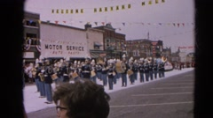 1964: school band opens weeklong celebrations in small town usa.  HARVARD Stock Footage