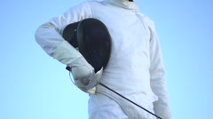 A man fencing on the beach. Stock Footage