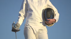 A woman fencing on the beach. Stock Footage