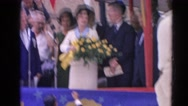 1964: lady on stage accepting bouquet of yellow flowers  HARVARD, ILLINOIS Stock Footage