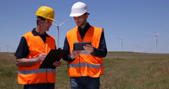 Clean Electricity Production Worker Men Talk Windpower Plant Farm Presentation Stock Footage