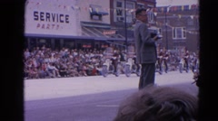 1964: motorbikes coming down road in local parade  HARVARD, ILLINOIS Stock Footage