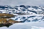 Norway scenic mountains with frozen lake. Stock Photos