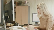Attractive young woman - Charming office working answering the phone in her Stock Footage