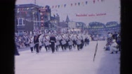 1964: marching band marches down the street during the parade  HARVARD, ILLINOIS Stock Footage