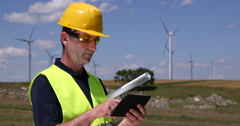 Windpower Plant Farm Technician Holding Touching Pad Using Digital Tablet Field Stock Footage