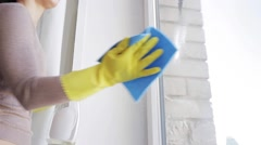 Woman in gloves cleaning window with rag Stock Footage