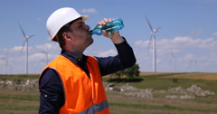Industrial Area Wind Turbines Dehydrated Worker Man Drinking Water Hot Dry Day Stock Footage