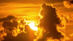 Sunrise sun rising behind dramatic tropical clouds. 4K UHD timelapse. Stock Footage