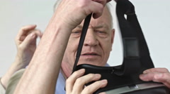 Senior Man Experiencing Virtual Reality Stock Footage
