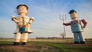 Steel Farmer Statue in Field Sunset TImelapse Stock Footage