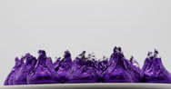 Chocolate Candy in Purple Wrapping Rotating Isolated on White, 4K Stock Footage