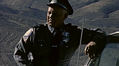 Nuclear test 1963: policeman in the desert of Nevada surveilling the area Stock Footage