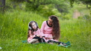Daughter and mother headphones Stock Footage
