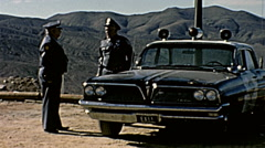 Nuclear test 1963: policemen surveilling the area Stock Footage