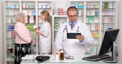 Drugstore Activity Pharmacist Man Working Touchpad Old Woman Customer Background Stock Footage