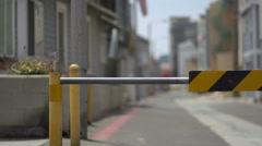 A barricade bar blocking an urban alley. Stock Footage
