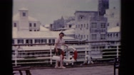 1951: woman walking on ship deck inspects floatation device FLORIDA Stock Footage