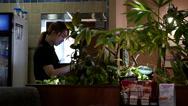 Motion of waitress printing bill for customer inside Denny's restaurant Stock Footage