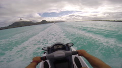 POV of man riding a personal watercraft in the lagoon around Bora Bora island in Stock Footage