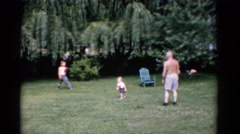 1951: a man and two small boys in backyard with baseball and gloves having fun. Stock Footage