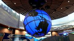 Motion of people looking fish inside Vancouver aquarium Stock Footage