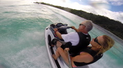 POV of a man and woman riding a personal watercraft in the lagoon around Bora Bo Stock Footage