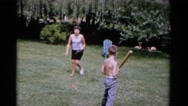 1951: a woman and children playing baseball in the yard FLORIDA Stock Footage