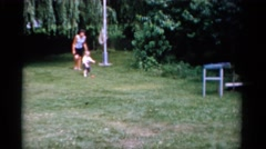 1951: outside in the yard toddler picks up ball and pitches to older boy FLORIDA Stock Footage