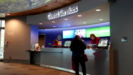 People buying ticket at guest service counter inside Vancouver aquarium Stock Footage