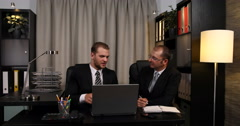 Executive Group Talking Using Laptop and Agenda Coworkers Collaborating Office Stock Footage