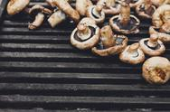 Mushroom barbecue roasted on metal grill background Stock Photos