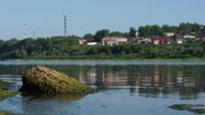 Summer scenic view of small town near river Stock Footage