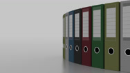 Colored office binders rotation, shallow focus. 4K seamless loopable clip Stock Footage
