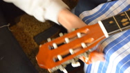 Unwinding String On Spanish Guitar Stock Footage