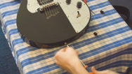 Electric Guitar Strap Change Stock Footage