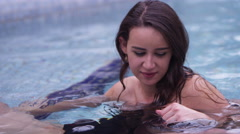 Hot Springs - Cute girl in water with boyfriend Stock Footage