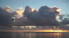 Clouds over South Pacific ocean during sunset in French Polynesia. Stock Footage
